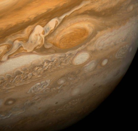 Jupiter and the great red spot, as captured by Voyager 1. The wake region to the left of the red spot is a cyclonic region of complex cloud and thunderstorm activity. Credit: NASA